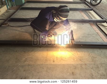 Thai welder working without safety at outdoor