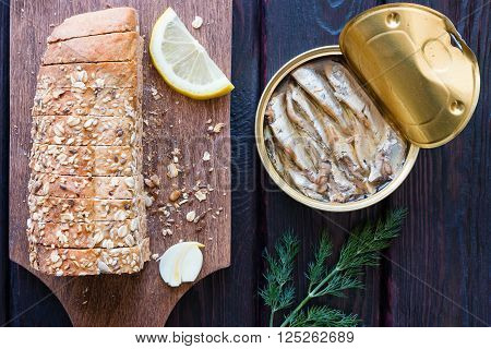 Bread With Seeds And Sprat In The Bank On A Black Background