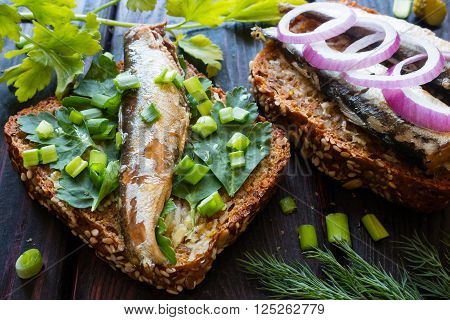 Sardines On Bread On Parsley Leaves Sprinkled With Onions