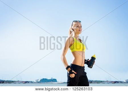 Young, beautiful, sporty and fit girl rollerblading on skates
