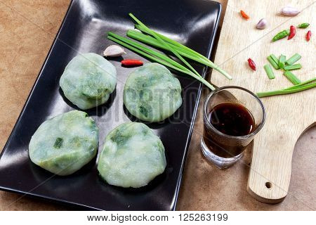 Allium tuberosum. Garlic chives with soy source. Dim sum is chinese cuisine.