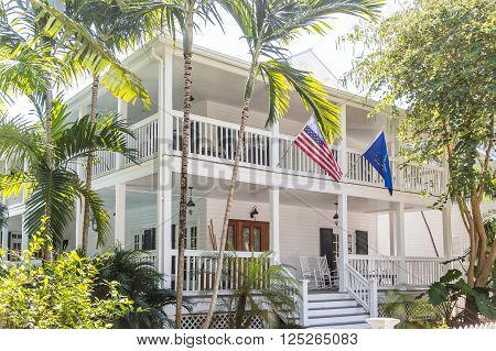 American Flag on White Wood House with Two Verandas in Key West