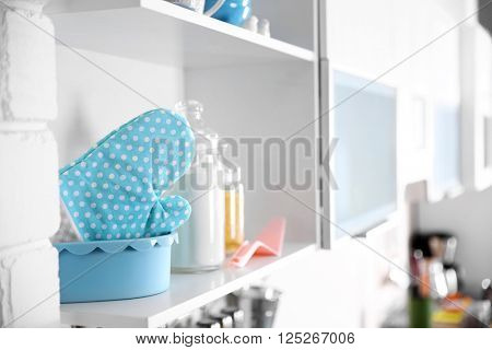 Tableware and kitchenware on a shelf