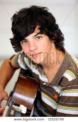 Closeup of teenager playing the guitar