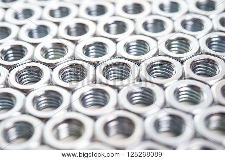 Metal nuts background