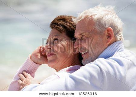 Portrait of happy senior couple at the beach