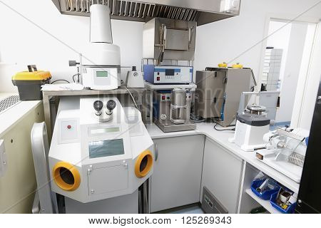 Computer controlled dental microscope in a hi-tech modern laboratory. Dentistry prostodontics prosthetics and medical technology and equipment concept.