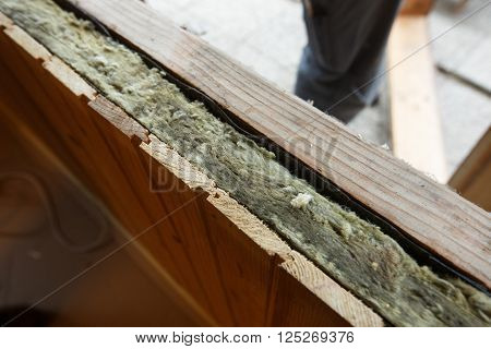 Exposed drywall insulation during window change in an old wooden house. Home renovation sustainable living energy efficiency concept.