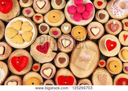 Valentine's Day concept. Different  hearts on wooden stumps background