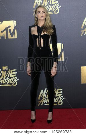 LOS ANGELES - APR 9:  Cara Delevingne at the 2016 MTV Movie Awards Arrivals at the Warner Brothers Studio on April 9, 2016 in Burbank, CA