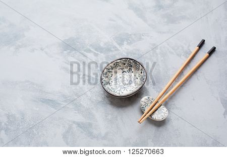 Chopsticks and sauce bowl with copyspace. Japanese Cuisine