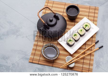 Japanese Cuisine. Traditional asian tea set and sushi. Food background with copyspace