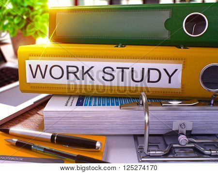 Yellow Office Folder with Inscription Work Study on Office Desktop with Office Supplies and Modern Laptop. Work Study Business Concept on Blurred Background. Work Study - Toned Image. 3D.