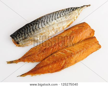 three smoked pieces of fish with skin isolated
