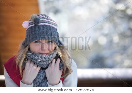 Portrait of a smiling woman at the snow