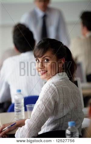 portrait of a smiling woman in a training room