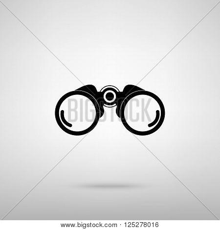 Binocular sign. Black with shadow on gray.