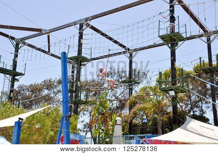 HILLARYS,WA,AUSTRALIA-JANUARY 22,2016: The Great Escape amusement playground with ropes course and person zip lining at Hillarys Boat Harbour in Hillarys, Western Australia.