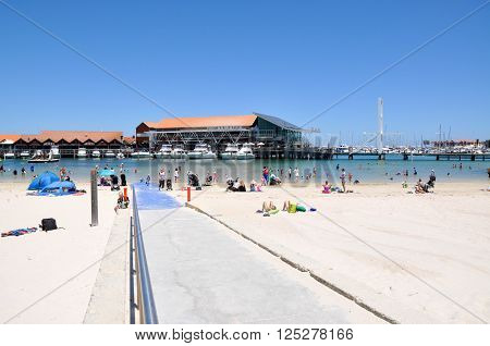 HILLARYS,WA,AUSTRALIA-JANUARY 22,2016: Beach recreation, boat ramp and yachts with swimming cove at Hillarys Boat Harbour, in Hillarys, Western Australia.