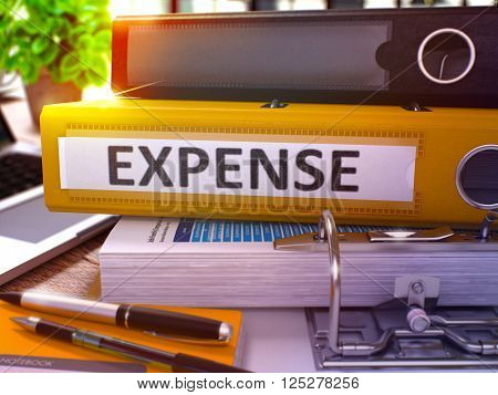 Yellow Office Folder with Inscription Expense on Office Desktop with Office Supplies and Modern Laptop. Expense Business Concept on Blurred Background. Expense - Toned Image. 3D.