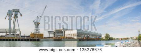 Shipyard crane landscape blurred. Blur backgrounds concept.