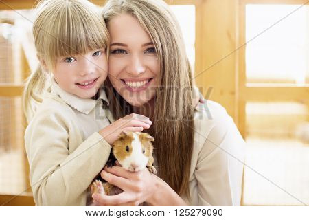 Mother and daughter in zoo