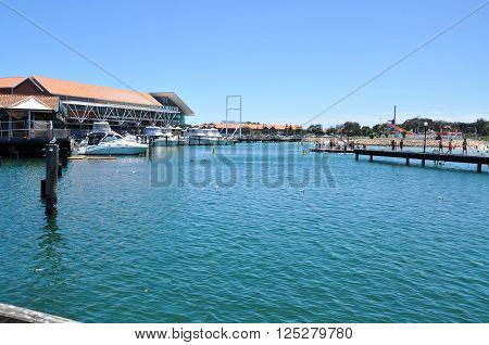 HILLARYS,WA,AUSTRALIA-JANUARY 22,2016: Cove with shops, restaurants, jetty and tourists at Hillarys Boat Harbour in Hillarys, Western Australia.