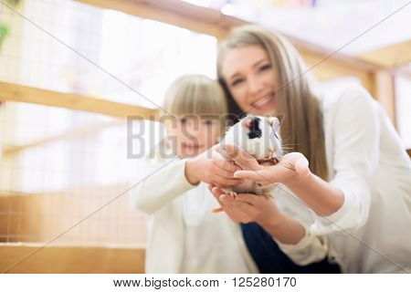 Mother and daughter with pets