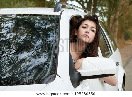 sad girl driver inside car portrait, look into the distance, summer season