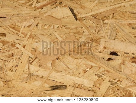 osb wood background, small pieces flat lay