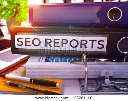 Black Office Folder with Inscription SEO  - Earch Engine Optimization - Reports on Office Desktop with Office Supplies and Modern Laptop. SEO Reports Business Concept on Blurred Background. 3D.