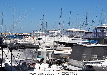 HILLARYS,WA,AUSTRALIA-JANUARY 22,2016: Yachts packed in the Marina in the boat pen at Hillarys Boat Harbour in Hillarys, Western Australia.