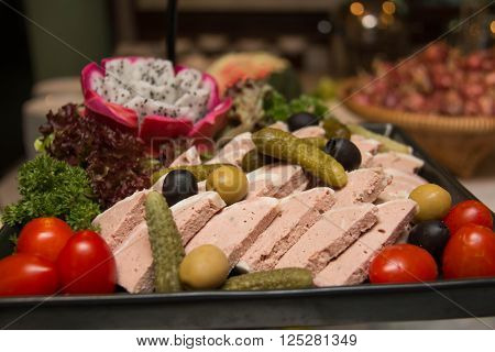 Assorted fresh cold cut platter served as a cold buffet