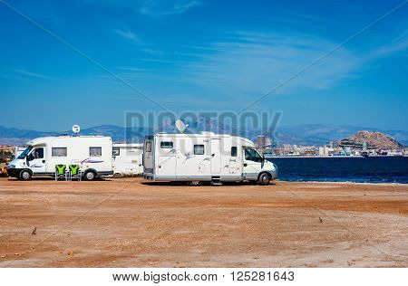 Alicante Spain- March 1 2016: Recreational vehicle station on the beach near Alicante city. Spain