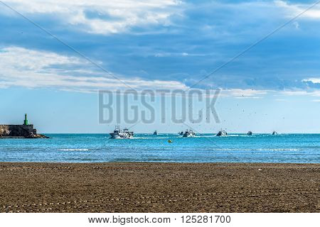 FIshing boats returning from fishing to the port of Peniscola province of Castellon Valencian Community Spain.