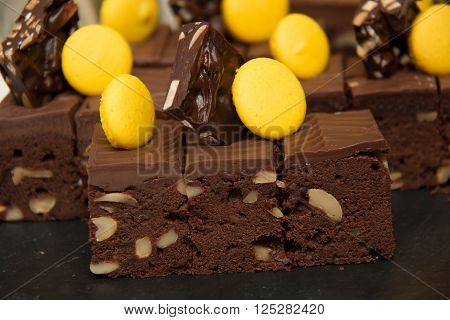 Chocolate Brownie cake on a dark plate ** Note: Soft Focus at 100%, best at smaller sizes