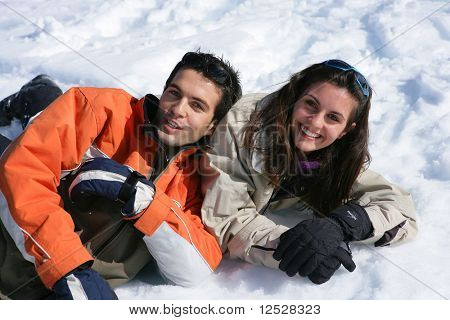 Portrait of happy couple in the snow