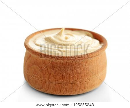 Wooden bowl of tasty hummus, isolated on white