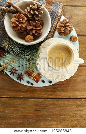 Cup of coffee and Christmas tree branch on napkin