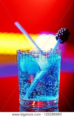 Glass of cocktail on bar background