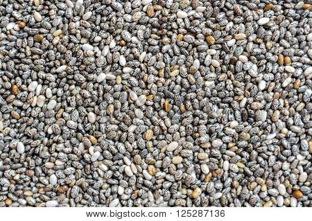 Organic chia seeds background texture pattern above view