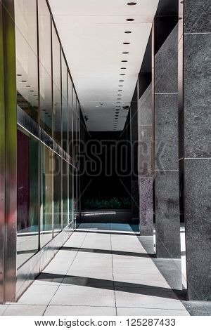 Sunlight streams through this contemporary building walkway in New York City.