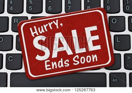 Hurry Sale Ends Soon Sign, A red sign with text Hurry Sale Ends Soon on a keyboard