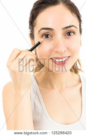 Caucasian woman using eyeliner. Isolated on white background.