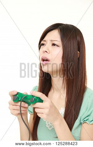 young Japanese woman losing playing video game