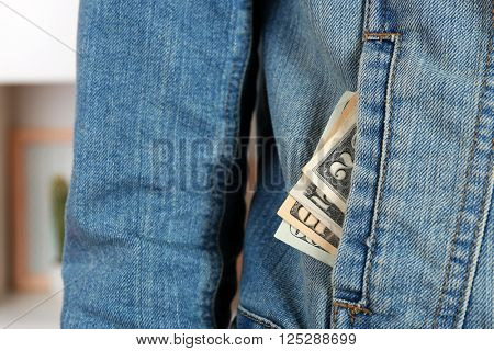 Money in the jeans jacket pocket, close up