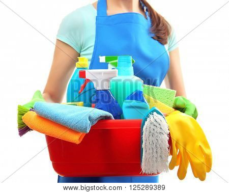 Young woman holding cleaning tools and products in tub, isolated on white