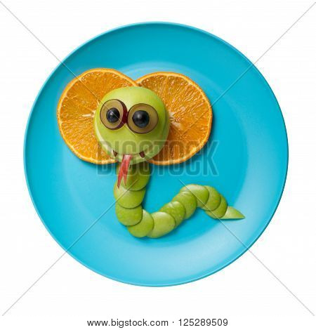 Cobra made of fruits on blue plate