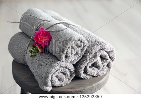 Towels with flowers on stool
