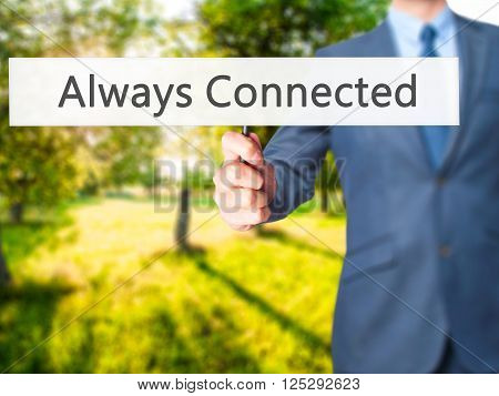 Always Connected - Businessman Hand Holding Sign